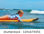 happy baby girl   young surfer... | Shutterstock . vector #1241674351