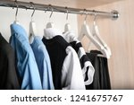 stylish boy's clothes hanging... | Shutterstock . vector #1241675767