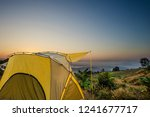 yellow tent at view point at... | Shutterstock . vector #1241677717