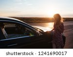 a girl stands by the car on the ... | Shutterstock . vector #1241690017