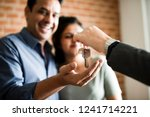 cheerful couple with keys to... | Shutterstock . vector #1241714221