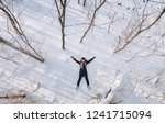 a pretty girl in a coat lies on ... | Shutterstock . vector #1241715094
