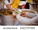 sharing food with people in... | Shutterstock . vector #1241757304