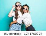 two lovely multiethnic women... | Shutterstock . vector #1241760724