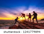 silhouette of hikers climbing... | Shutterstock . vector #1241779894