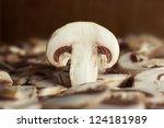 Close up photo of sliced piece of champignon mushroom - stock photo