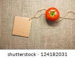 tomato vegetable and price tag on sacking background texture - stock photo