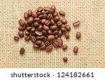 coffee beans on sacking background - stock photo