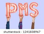 hands holding pms word in...   Shutterstock . vector #1241838967