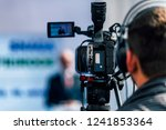 cameraman wearing headphones... | Shutterstock . vector #1241853364