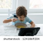kids in dining room eating and... | Shutterstock . vector #1241869204