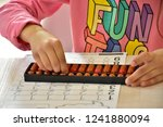 abacus and fingers | Shutterstock . vector #1241880094