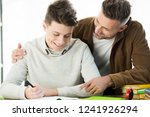 smiling father hugging cheerful ... | Shutterstock . vector #1241926294