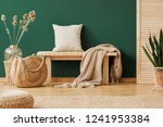 blanket and pillow on wooden... | Shutterstock . vector #1241953384