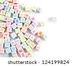 Stock photo image of various colorful blocks with the alphabet isolated on a white background 124199824