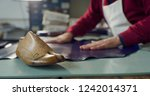 close up of a shoemaker working ... | Shutterstock . vector #1242014371