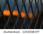 fence and dusk | Shutterstock . vector #1242038197
