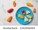 colorful sweet mini peppers in... | Shutterstock . vector #1242046444