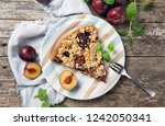 piece of home made plum cake on ... | Shutterstock . vector #1242050341