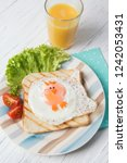 funny toast with fried eggs in... | Shutterstock . vector #1242053431
