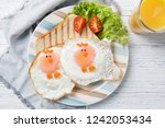 funny toast with fried eggs in... | Shutterstock . vector #1242053434