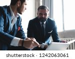 business executives discussing... | Shutterstock . vector #1242063061