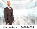 happy business man portrait at... | Shutterstock . vector #1242096634