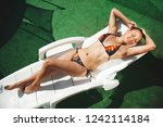 young woman sunbathing on a sun ... | Shutterstock . vector #1242114184