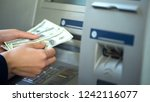 woman counting dollars... | Shutterstock . vector #1242116077