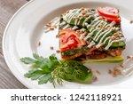 Stock photo vegetarian dish lasagna with zucchini mushrooms tomatoes basil wheat germ spinach garlic 1242118921