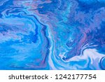 blue and white color paint... | Shutterstock . vector #1242177754