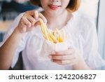 asian white shirt women enjoy... | Shutterstock . vector #1242206827