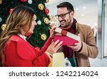 new year's surprise for a... | Shutterstock . vector #1242214024