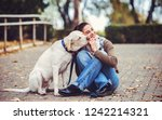 Stock photo dog owner have fun in the park with a pet friendship between human and dog pets and animals 1242214321