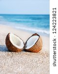 Two Halfs Of Coconut Against...