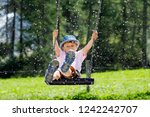 funny kid boy having fun with... | Shutterstock . vector #1242242707