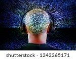 teen wearing headphones... | Shutterstock . vector #1242265171