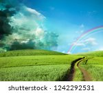 dark stormy clouds and sun ... | Shutterstock . vector #1242292531
