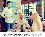 happy smiling male waiter... | Shutterstock . vector #1242297127