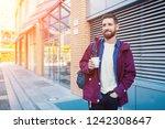 handsome young man in purple... | Shutterstock . vector #1242308647