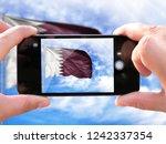 the hands of men make a phone... | Shutterstock . vector #1242337354
