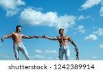 primed for victory. men shows...   Shutterstock . vector #1242389914