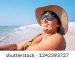 happy smiling elderly woman in... | Shutterstock . vector #1242393727