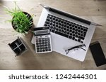 top view.laptop  calculator and ... | Shutterstock . vector #1242444301