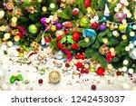 christmas tree with broken... | Shutterstock . vector #1242453037