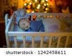 adorable newborn baby boy ... | Shutterstock . vector #1242458611