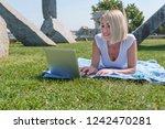 young beautiful woman smiling...   Shutterstock . vector #1242470281