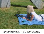 young woman laying down on the...   Shutterstock . vector #1242470287