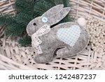 Stock photo textile handmade felt toys hares and rabbits on christmas tree 1242487237
