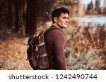 a young hiker enjoying a walk...   Shutterstock . vector #1242490744